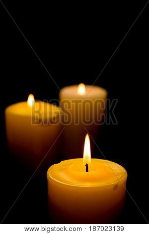 Candles isolated on black blazing flame candle burning candle light illuminate