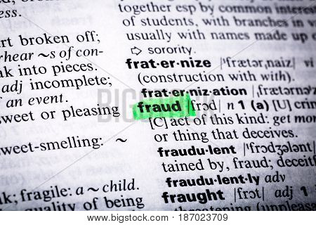 Close up word concept fraud highlighting definition dictionary