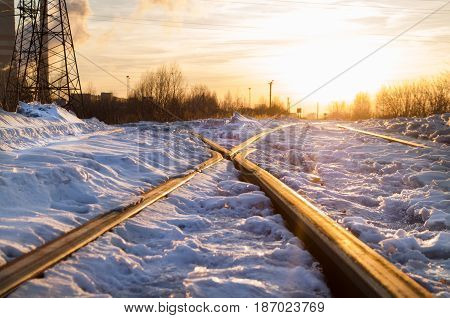 Railroad crossing in sunset rays. Travel concept background.