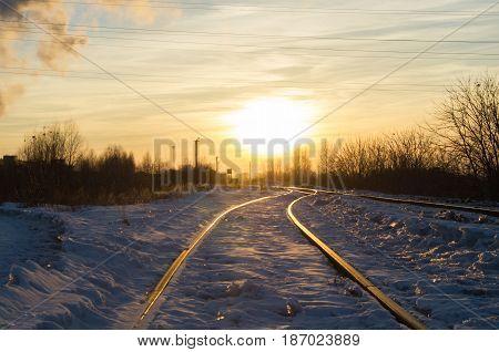 Empty railroad in the light of sun.