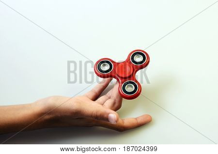 red Hand spinner fidgeting hand toy rotating