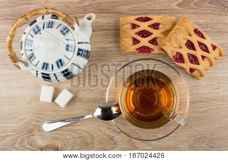 Cup With Tea, Spoon, Lumpy Sugar, Teapot And Pies