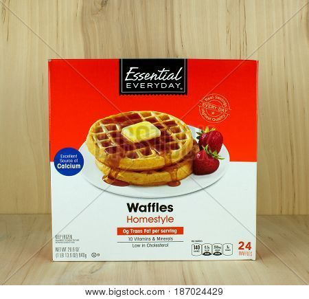 RIVER FALLS,WISCONSIN-MAY 172017: A box of home-style frozen waffles with a wood background.