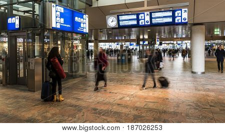 Rotterdam The Netherlands - March 10 2017: Travelers walking in the hall of the railway station of Rotterdam in the Netherlands.