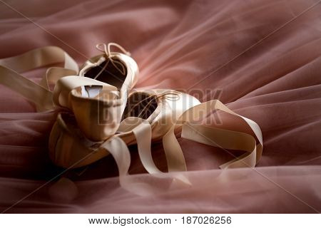 Pointe Ballet Shoes on pink background. Pointe shoes for a ballerina.