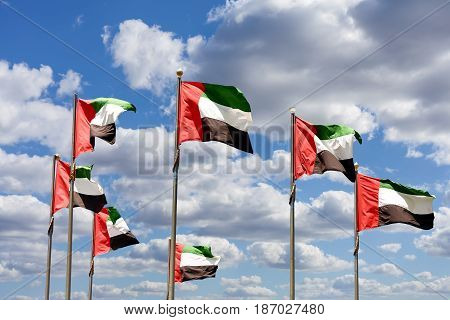 Seven United Arab Emirates flags represent federation of seven emirates.