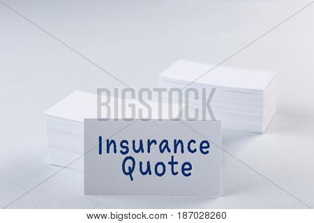 Insurance quote concept. Business cards on light background