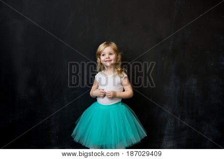 Beautiful girl dreams. Background - board for chalk.
