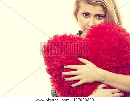 Sad Girl Holding Big Red Pillow In Heart Shape