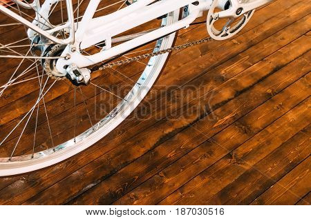 The Wheel Of A Stylish Bicycle With A White Rim And A Brown Rubber Tire, A Chain, An Asterisk On A S