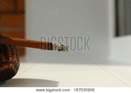The Burning , Glowing , smoldering cigarette