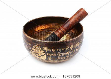 Singing Tibetan bowl on a white background.