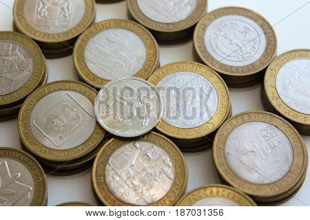 Jubilee Russian ten-ruble coins and the ruble symbol