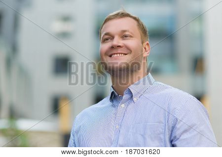 Portrait of happy Handsome businessman in blue shirt outdoor.