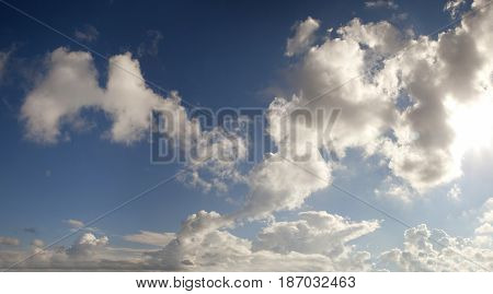 Panorama blue sky with cumulus clouds in contrast
