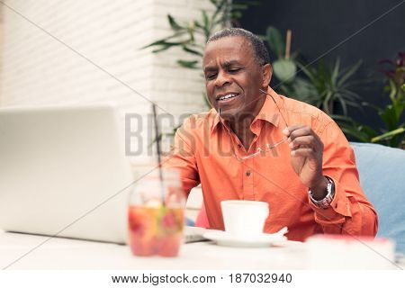 Businessman checking email and drinking coffee closeup picture