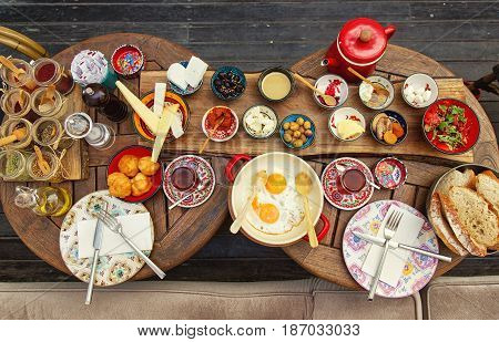 Rich and delicious traditional Turkish breakfast on a laid table