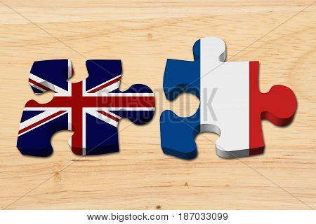 Relationship between the Britain and France Two puzzle pieces with the flags of Britain and France on wood 3D Illustration