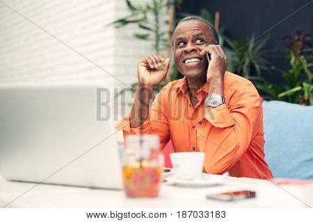 Businessman in a cafe, talking on mobile