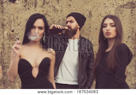 Woman Smoking Cigarette With Friends