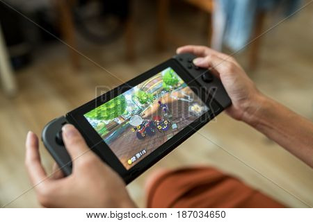 Hong Kong, 16 May 2017 -:Woman playing Nintendo Switch at home