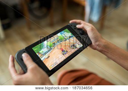 Hong Kong, 16 May 2017 -:Woman playing Nintendo Switch