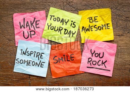 wake up, be awesome, inspire someone, smile, you rock - set of inspirational sticky notes against rustic wood poster