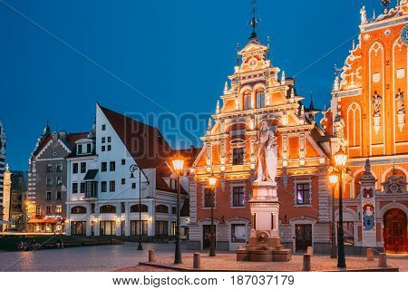 Riga, Latvia - July 1, 2016: Schwabe House And House Of The Blackheads At Town Hall Square, Ancient Historical Landmark And Popular Touristic Showplace In Summer Evening. Night Illuminations