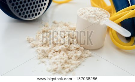 Sports Nutrition And Supplements For Bodybuilding, Close-up. Protein And Shaker On White Background