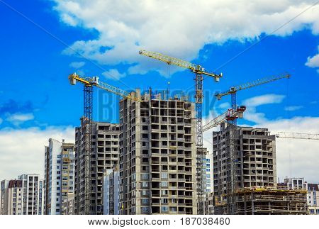 Belarus Minsk 11 May; 2017; Modern civil construction industrial tower cranes against the blue sky; Modern urban landscape editorial
