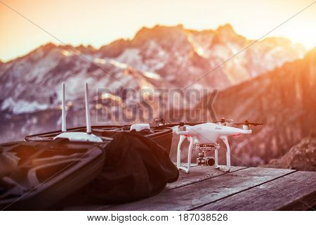 Drone ready to flight in front of high mountains.