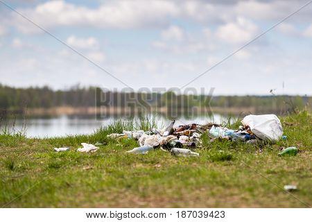 Garbage dump on the lake . Environmental problem