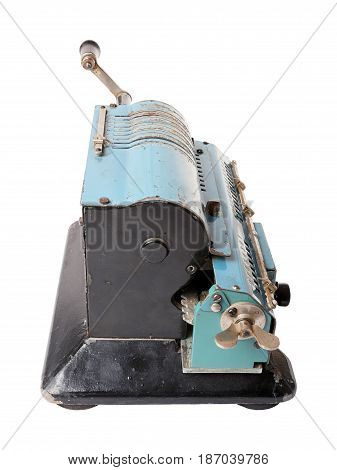 Old blue calculating machine isolated on a white background. Side view.