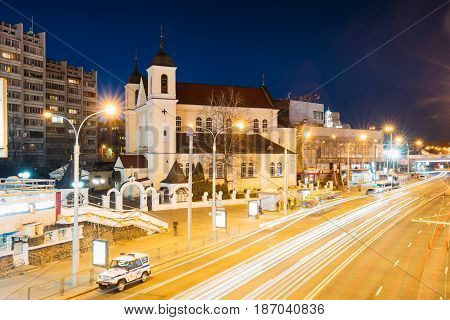Minsk, Belarus - April 3, 2017: Evening Night Traffic Near Cathedral of Saints Peter and Paul On Illuminated Nemiga Street In Minsk, Belarus