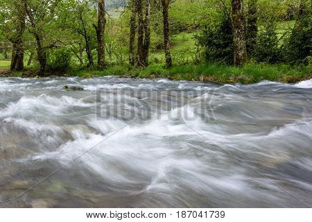 French countryside. Small wild river in the Vercors Natural Park near the Bouvante lake.