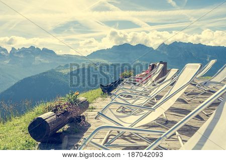 Young woman enjoying mountain view. Brenta group above Madonna di Campiglio.