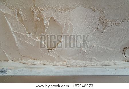 Ruler is aligning a gypsum plaster on the wall.