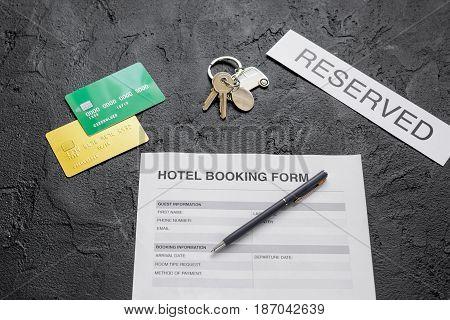 booking hotel room application form on dark desk background