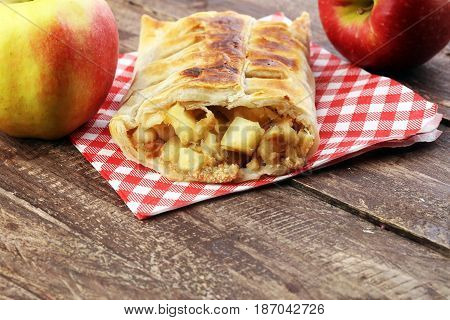 Fresh Baked Homemade Apple Strudel With Powdered Sugar And Mint Leaves.