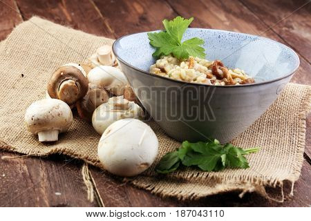 Risotto With Mushrooms, Fresh Herbs And Parmesan Cheese.