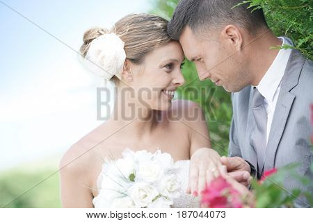 Bride and groom exchanging vows and wedding ring