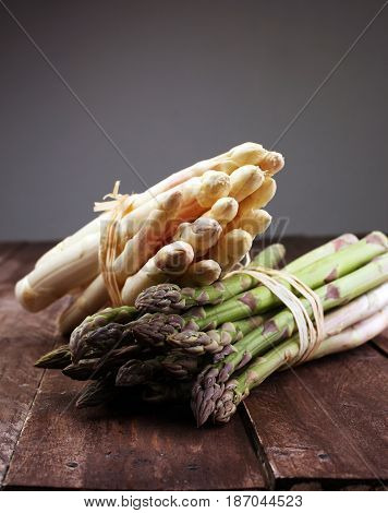Bunch Of Fresh White Asparagus And Green Asparagus On Table