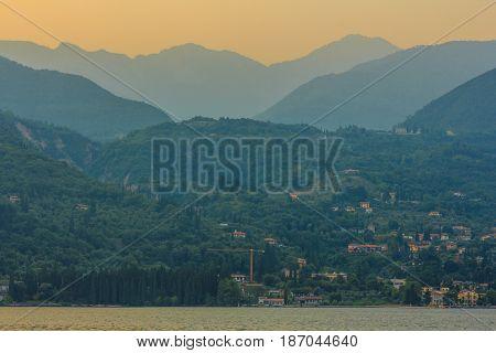 Lake Garda Italy - June 6 2014: sun setting over lake Garda and mountains