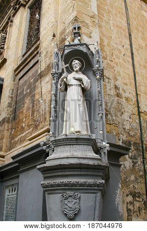 Saint statue Valletta streets in Malta island