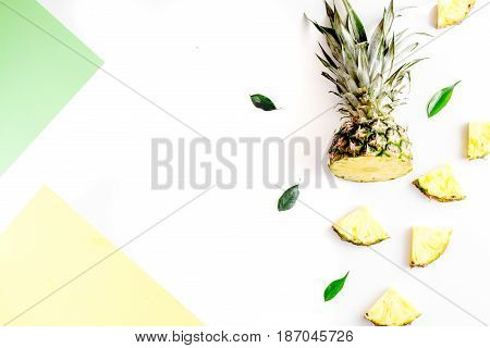 sliced exotic fruits for summer dessert on white background top view space for text