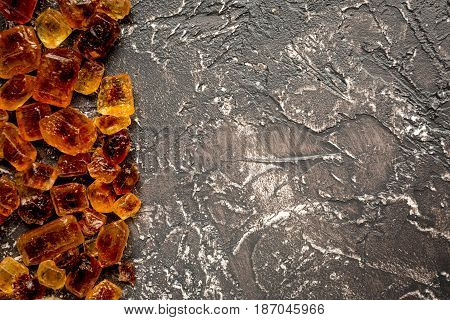 lumps of sugar on dark kitchen table background top view space for text