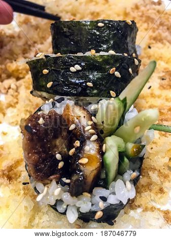 Rolls with fish and cucumber with sesame and crispy breading. Studio Photo