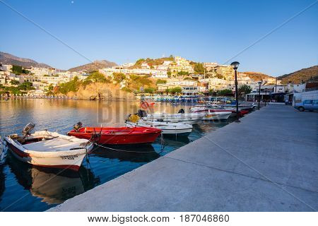 Village Bali Island Crete Greece - June 24 2016: Beautiful morning scenery with mountains bay of Mediterranean sea and a pier with fishing boats are near the pier.