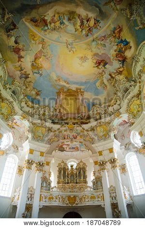Steingaden, Germany - June 5, 2016: The pipe organ in Pilgrimage Church of Wies. It is an oval rococo church, designed in the late 1740s by Dominikus Zimmermann. Region of Upper Bavaria, Germany.