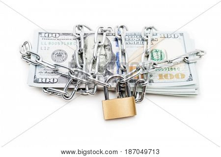 Business safety and finance protection concept - metal chain link with locked padlock on dollar currency money white isolated